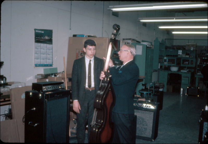 February 1967 at the Ampeg factory - getting a private lesson on the Baby Bass from Everett Hull.